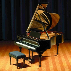 Concert grand piano with upholstered bench